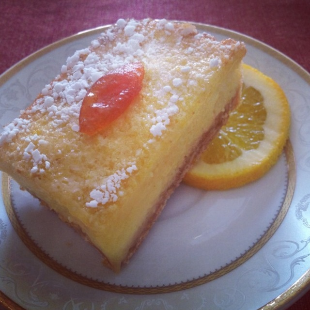 My Meyer lemon bars garnished with candied kumquat.
