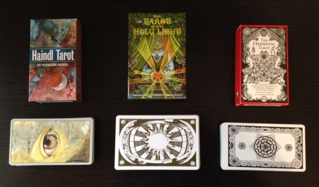 Tarot Decks (left to right): Haindl, Holy Light, and Hermetic