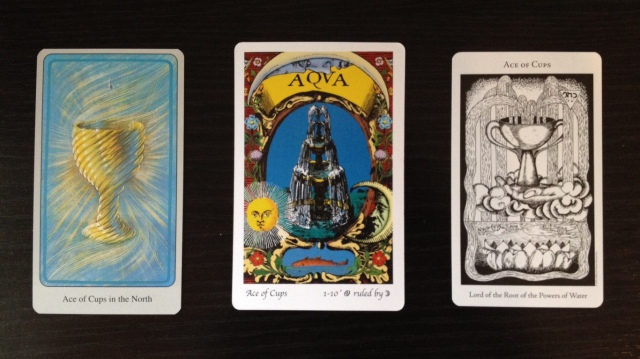 Ace of Cups from the Haindl, Tarot of the Holy Light, and Hermetic Tarot